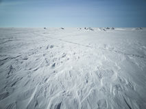 Sea in winter in Siberia. Snow and ice on the sea to the shore Stock Photography