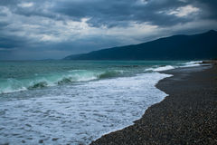 Sea With Waves And Dark Sky Stock Images