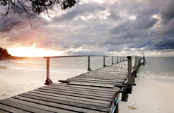 Sea wooden bridge in the morning. Of rainy season photo in the early of the morning with sunrise dark and  lowlight under cloudy lighting Royalty Free Stock Photos
