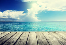 Sea and wooden platform Stock Image