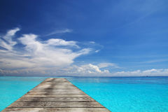 Sea and wooden walkway Royalty Free Stock Images