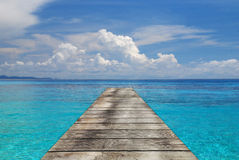 Sea and wooden walkway Stock Images