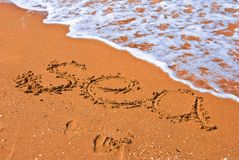 Sea word on a beach Stock Images