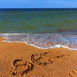 Sea word  on a sand Stock Images