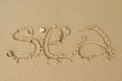 Sea. Word sea written on the sand Stock Photos