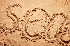 Sea written on sand Royalty Free Stock Images