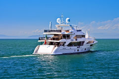 Sea yacht. Huge luxury yacht floating on sea near italian coast Royalty Free Stock Photo