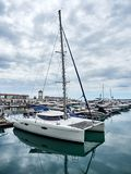 Sea yacht-catamaran docked in port royalty free stock images