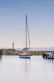 Sea yacht comes into port in ity Groemitz, Northern Germany, coast of Baltic Sea am 09.06.2016. Travel, holiday at sea royalty free stock photography