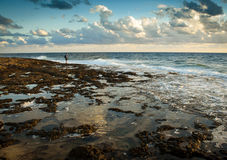 Sea. Young alone man, waves and Mediterranean sea Royalty Free Stock Image