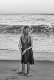 The Sea. A Young Girl Staring At The Sea Stock Photography