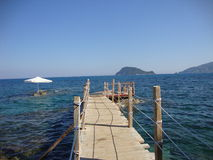 Sea in Zante. Wooden pier, which leads to the beautiful sea in Zante Royalty Free Stock Photos