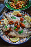 Homemade seabass with parsley Royalty Free Stock Photography