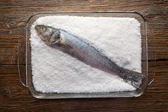 Seabass baked in sea salt seabass crusted Royalty Free Stock Images