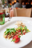 Seabass carpaccio on restaurant table Royalty Free Stock Photography