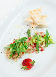 Seabass carpaccio with strawberry Royalty Free Stock Image