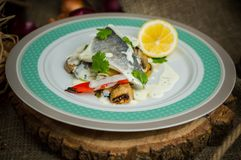 Seabass with vegetables royalty free stock photo