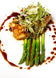 Seabass fillet with asparagus Royalty Free Stock Photos