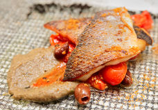 Seabass fillet cooked in Sicilian way Stock Photos
