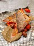 Seabass fillet cooked in Sicilian way Stock Photo