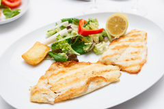 Seabass fillet in plate Stock Photo