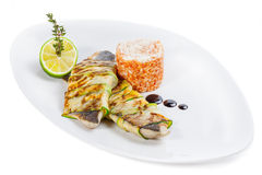 Seabass fillet with rice and lemon.  royalty free stock photo