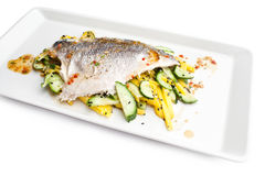 Seabass fillet served. With cucamber and potato on a white plate Stock Photos