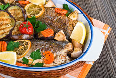 Seabass fish baked with vegetables, close-up Stock Photography