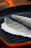Seabass in a griddle pan Stock Photography