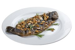 Seabass grill on a white plate. On a white background royalty free stock photo