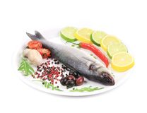 Seabass on plate with citrus and pepper. Stock Photography