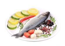 Seabass on plate with citrus and pepper Stock Image