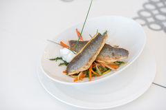 Seabream on white plate Royalty Free Stock Image
