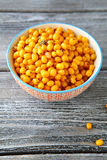 Seabuckthorn acid in a bowl on boards Royalty Free Stock Photo