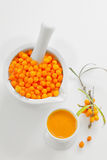 Seabuckthorn Berries and juice. On white Background Royalty Free Stock Photography