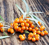 Seabuckthorn Berries. On Wooden Background Royalty Free Stock Photography