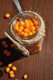Seabuckthorn. In jar,  Background from sea-buckthorn berries (Hippophae rhamnoides). This product contain plenty of vitamin C Stock Photo