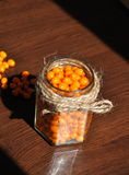 Seabuckthorn. In jar,  Background from sea-buckthorn berries (Hippophae rhamnoides). This product contain plenty of vitamin C Royalty Free Stock Photo