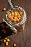 Seabuckthorn. In jar, Background from sea-buckthorn berries (Hippophae rhamnoides). This product contain plenty of vitamin C Royalty Free Stock Image