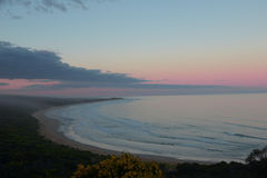 Seacaost in the dusk. Surfing beach in the pink dusk Royalty Free Stock Images