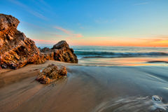 Seacape and beach in sunset Royalty Free Stock Image