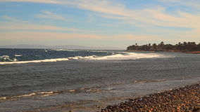 Seacoast. On the horizon you can see the mountains.  stock footage