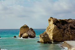 Seacoast with Petra tou Romiou or Aphrodite`s Rock Royalty Free Stock Image