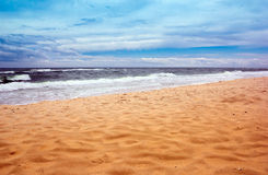 Seacoast with sea and sand Royalty Free Stock Image