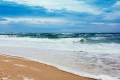 Seacoast with sea and sand Stock Photos