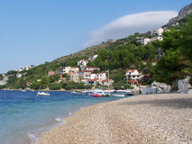 Seacost in Croatia. Beautiful view to a seacoast with trees and houses in Croatia Royalty Free Stock Photos