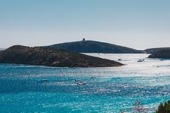 Seacsape of Teulada with some boats in the sea - summer season in a sunny day - Sardinia.  royalty free stock images