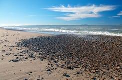 Gravel on beach at McGrath State Park in Oxnard California USA stock photos