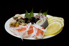 Seafood. Sea salad with lemon Royalty Free Stock Photography