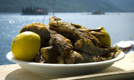 Seafood. Lot of fish and lemon, behind sea Royalty Free Stock Images